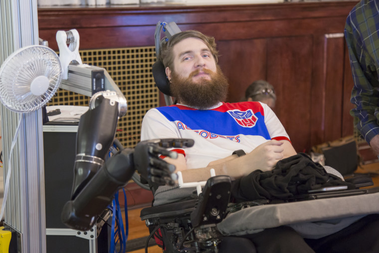 A brain implant has allowed Nathan Copeland to sense touch using a robotic hand.