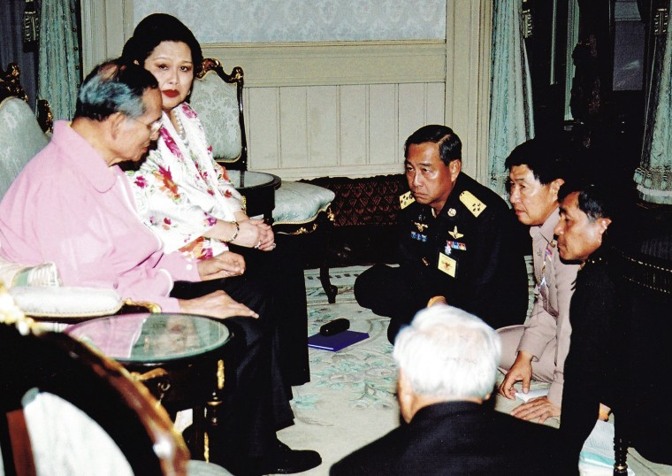 Image: Thai King Bhumibol Adulyadej and Queen Sirikit meet with Thailand's military coup leaders in Bangkok