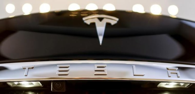 A Tesla logo adorns a 'Model S' car in the dealership in Berlin