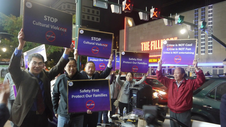 """Chinese Americans gather outside Wednesday night at The Fillmore, a concert venue, in Silver Spring, Maryland, to protest a 2014 song by rapper YG called """"Meet the Flockers."""""""