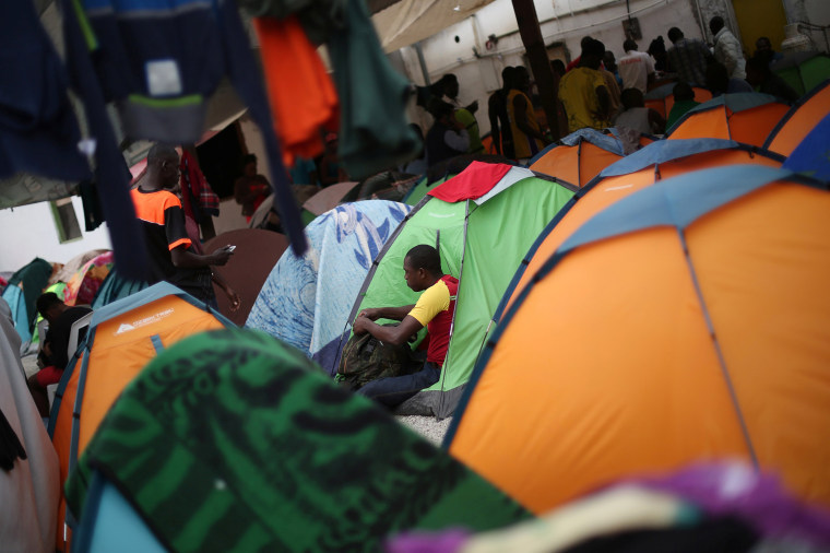 Image: Haitian migrants are seen at the Juventud 2000 shelter, where they relocated to after leaving Brazil due to Haiti's 2010 earthquake, in Tijuana, Mexico