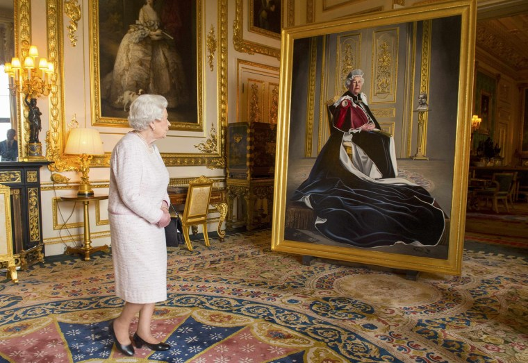 Image: Britain's Queen Elizabeth views a portrait of herself by British artist Henry Ward, commissioned to mark her six decades of patronage to the British Red Cross, at Windsor Castle