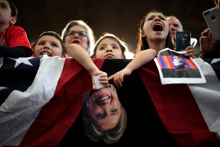 Image: People listen to Hillary Clinton at a rally at the Colorado State Fair Grounds in Pueblo