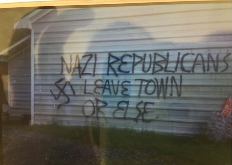 Authorities in North Carolina were investigating the firebombing of a GOP office and threatening graffiti nearby.