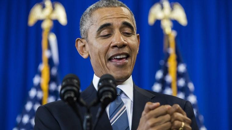 President Barack Obama pretends to be texting.