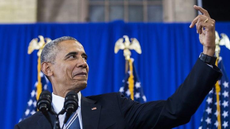 President Barack Obama pretends to take a selfie