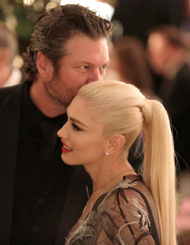 Gwen Stefani receives a kiss from Blake Shelton during a State Dinner at the White House in Washington