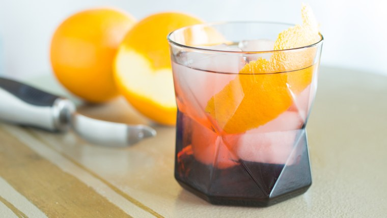 Negroni with an orange twist made with a vegetable peeler