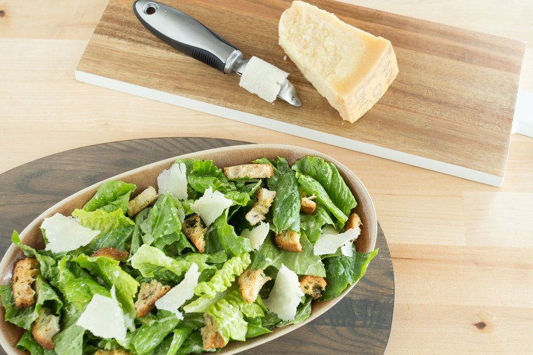 Caesar salad with cheese curls made with a vegetable peeler