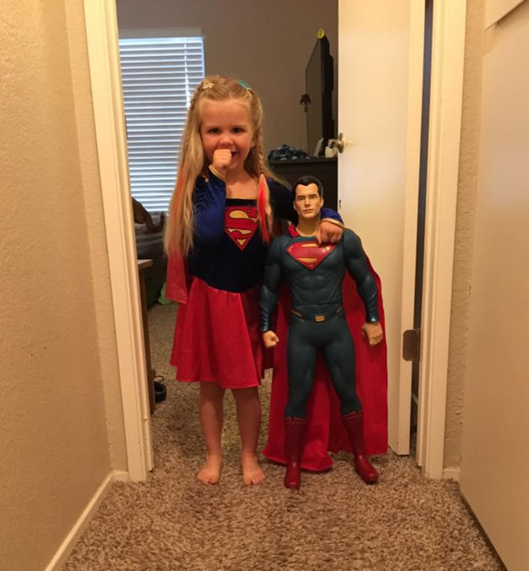 Kaylieann poses next to her Superman doll!