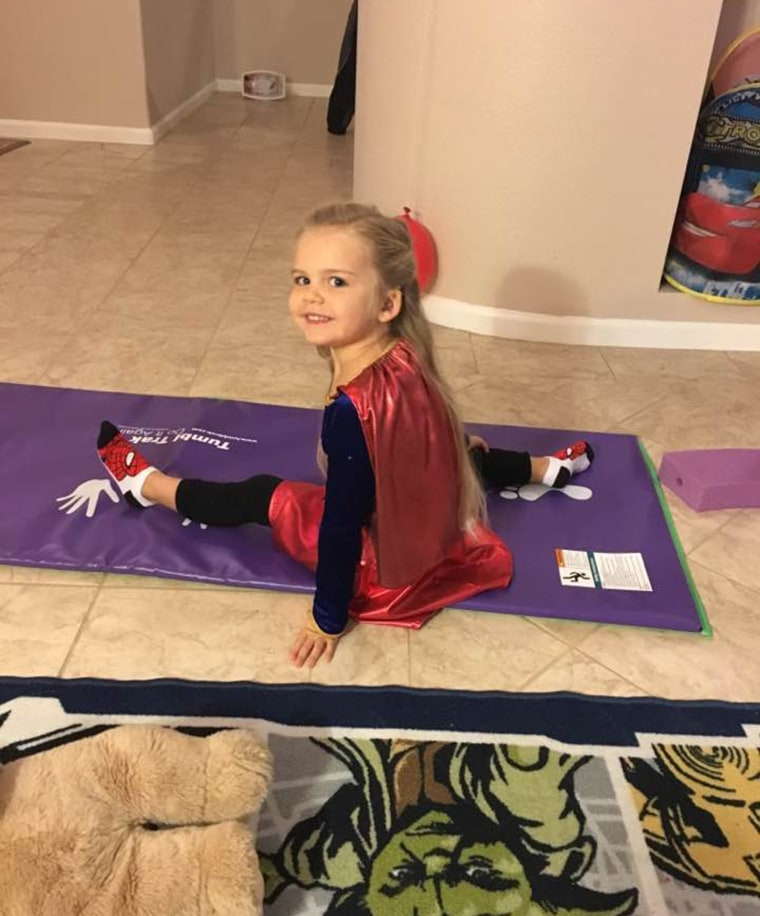 3-year-old refuses to wear anything other than her Supergirl costume for school picture day.