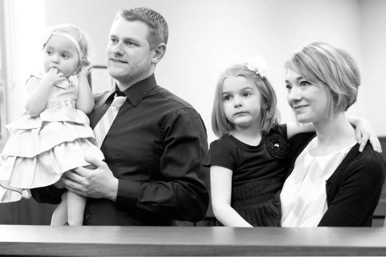 Rachel Lewis with her family: Husband Ryan, and daughters Madelyn and Leyla.