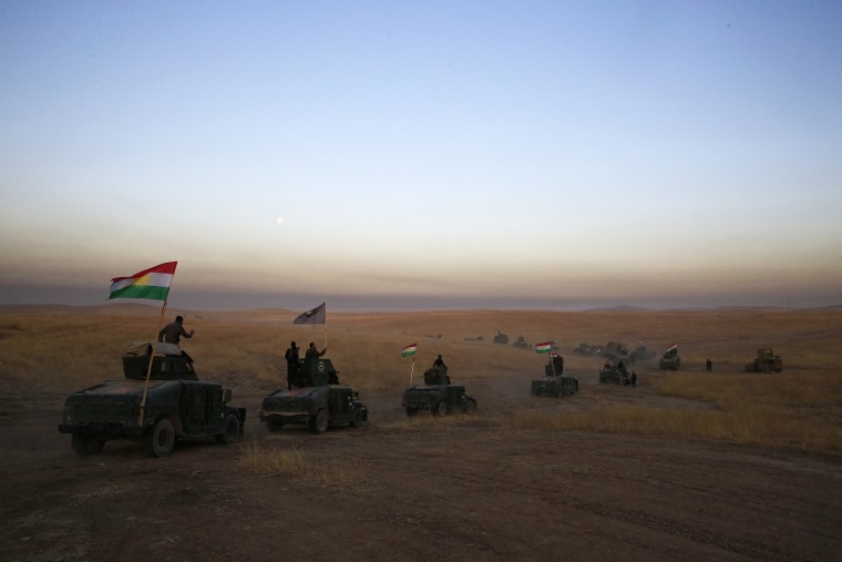 Image: A Peshmerga convoy drives towards a frontline in Khazer, about 30 kilometers (19 miles) east of Mosul