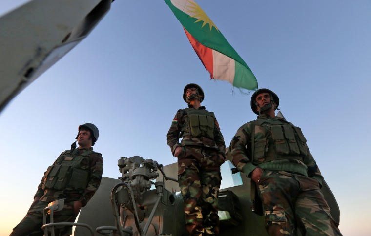 Image: Iraqi Kurdish Peshmerga fighters hold a position on the top of Mount Zardak