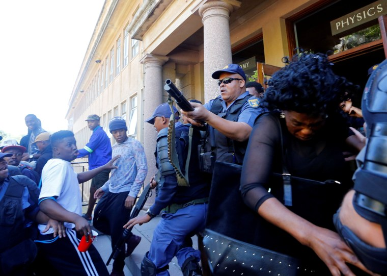 Image: University of Cape Town students clash with police as stun grenades are used during protests demanding free tertiary education in Cape Town