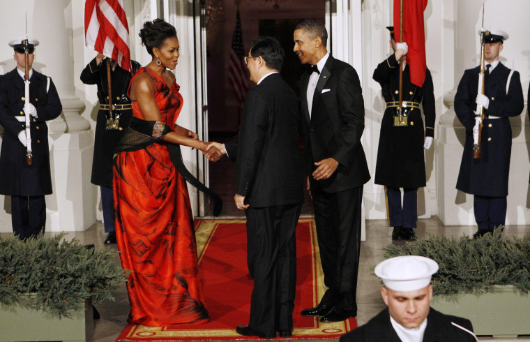 Image: U.S. President Obama and first lady Michelle greet China's President Hu as he arrives for a State Dinner in his honor at the White House in Washington