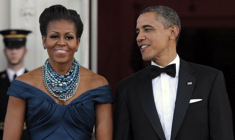 Image: Obama and Michelle wait to welcome Britain's Prime Minister David Cameron and his wife Samantha Cameron
