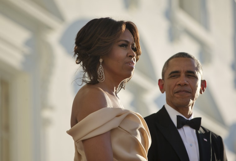 Image: Obama and Michelle wait for the arrival of Nordic Leaders