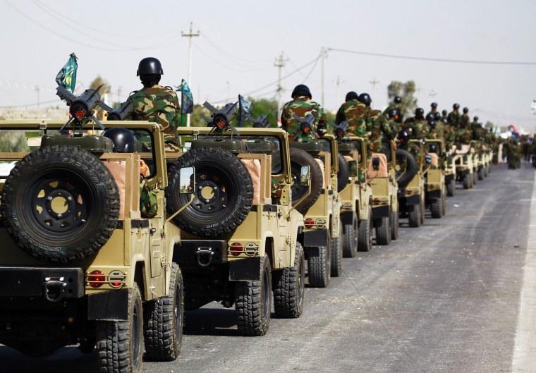 Image: Members of the Popular Mobilisation Units near Najaf