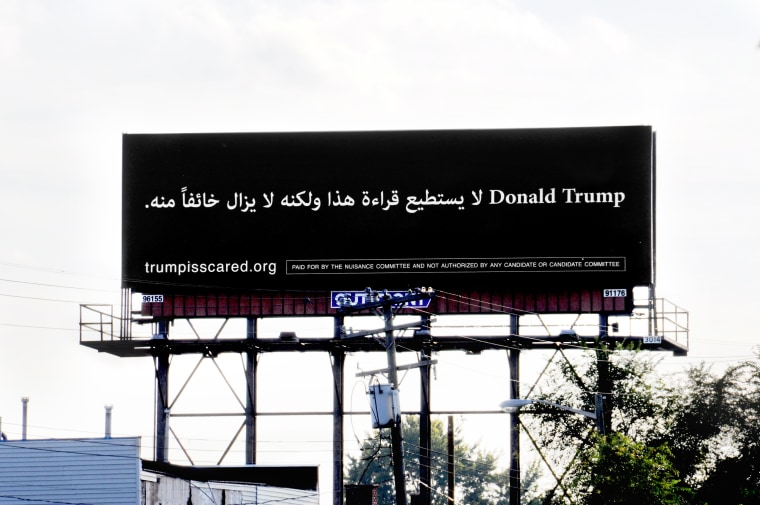 The billboard by the Nuisance Committee super PAC sits on I-94 in Dearborn, Mich.