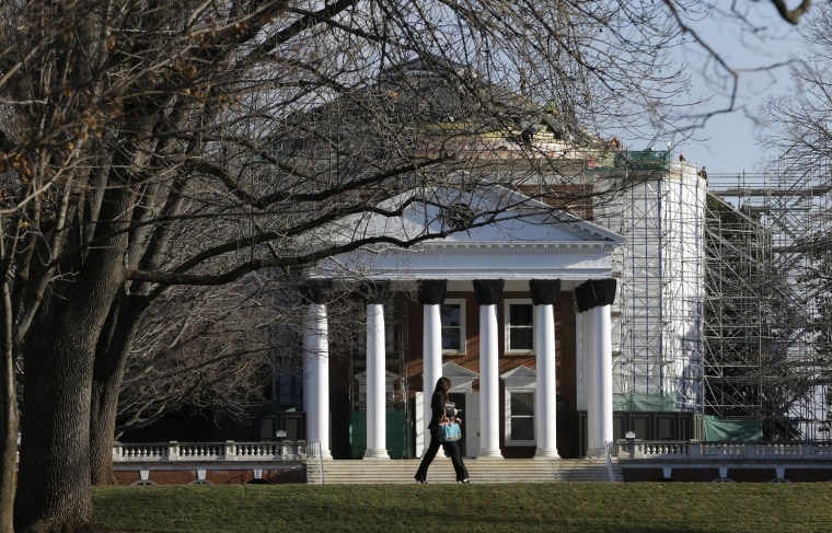 Image: A student walks across the Lawn in front of the Rotunda at the University of Virginia