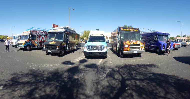 Photo of taco trucks parked in Las Vegas, drawing in potential eligible voters to register people to vote.