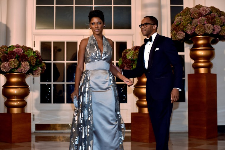Image: Tamron Hall of MSNBC (L) and Jonathan Todd Capehart (R) arrive for a State Dinner honoring Italian Prime Minister Matteo Renzi at the White House in Washington