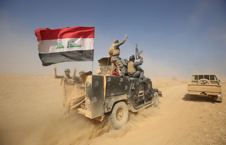 Image: Iraqi forces deploy in the Bajwaniyah village, about 30 kms south of Mosul, after they liberated it from Islamic State
