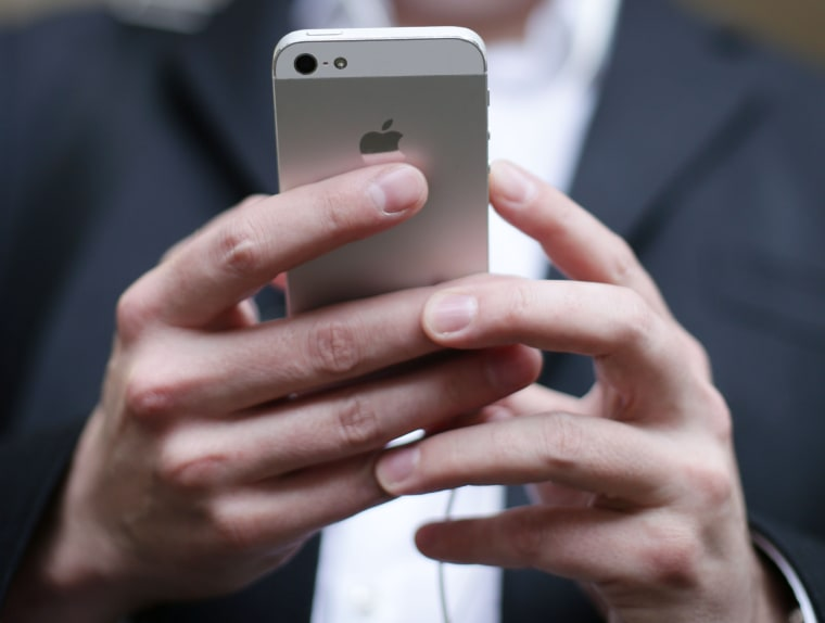 Image: A person uses an iPhone