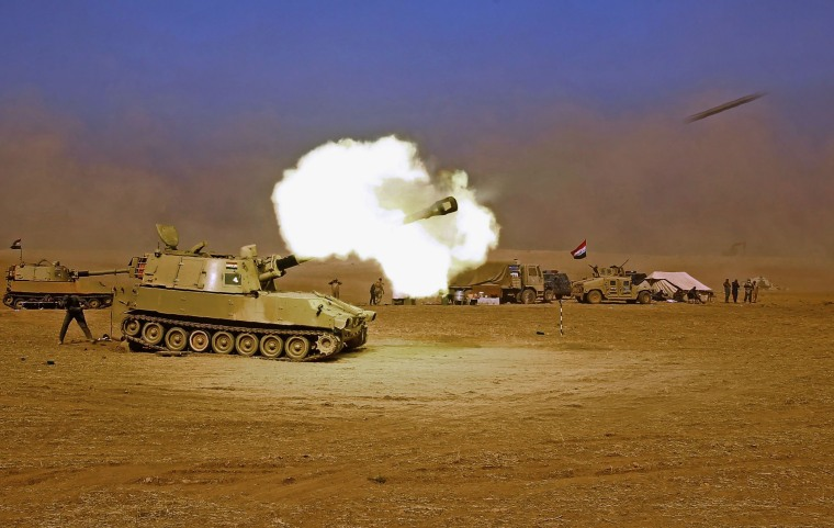 Image: An Iraqi forces M109 self-propelled howitzer fires towards the village of Tall al-Tibah