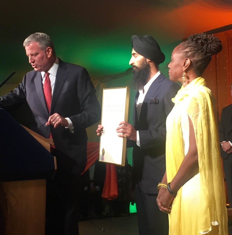 Ahluwalia (center) with New York City Mayor Bill de Blasio (left) and the First Lady of New York City Chirlaine McCray.
