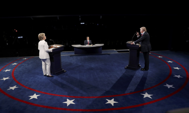 Image: Trump speaks as Clinton listens during their third and final 2016 presidential campaign debate at UNLV in Las Vegas