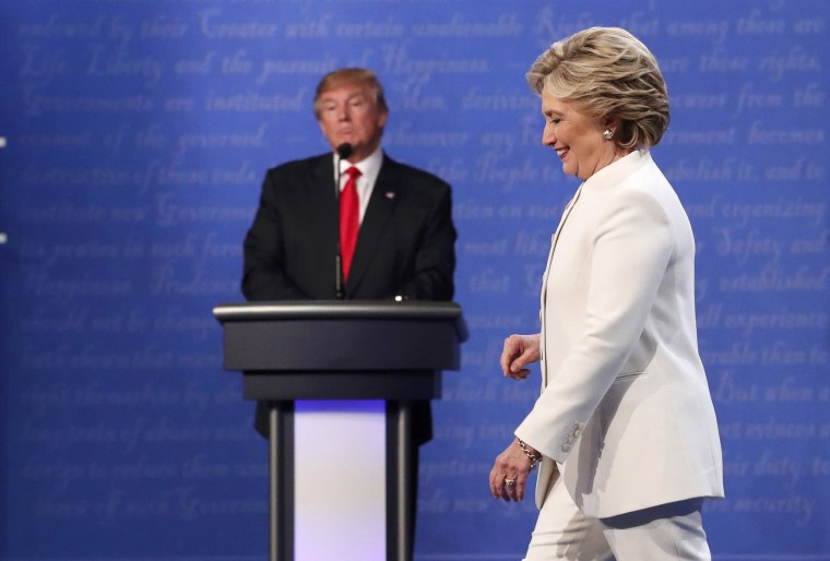Image: Democratic U.S. presidential nominee Clinton walks off the debate stage as Republican U.S. presidential nominee Trump remains at his podium after the conclusion of their third and final 2016 presidential campaign debate in Las Vegas
