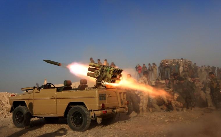 Image: Iraqi Kurdish peshmerga fighters fire a multiple rocket launcher