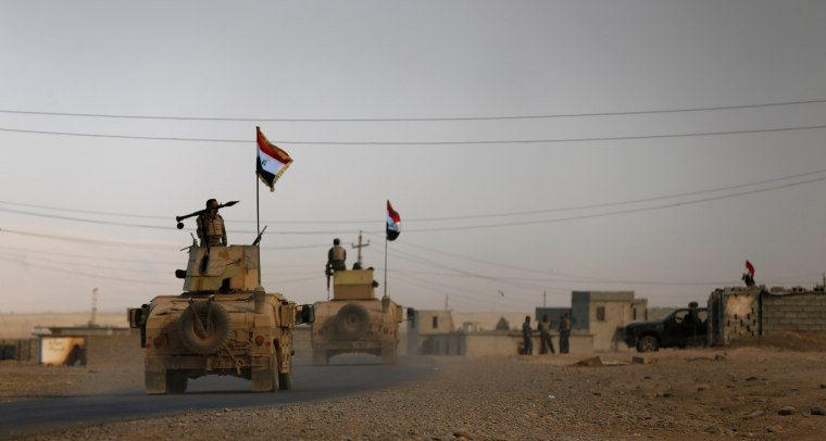 Image: Iraqi army gather after the liberation of Khalidiya village from Islamic State militants, south of Mosul, during an operation to attack Islamic State militants in Mosul