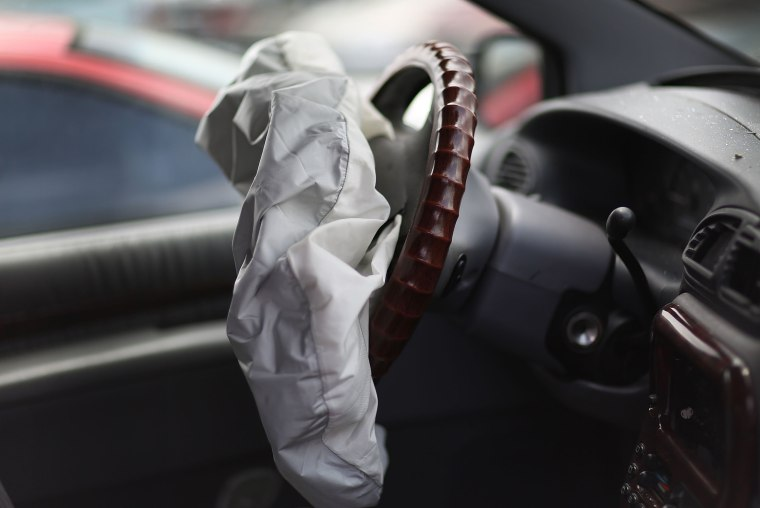 Image:  A deployed airbag is seen in a Chrysler vehicle