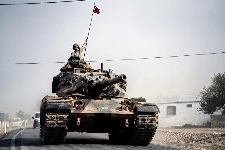 Turkish army tanks and armored personnel carriers move toward the Syrian border, in Karkamis, Turkey, Thursday, Aug. 25, 2016.