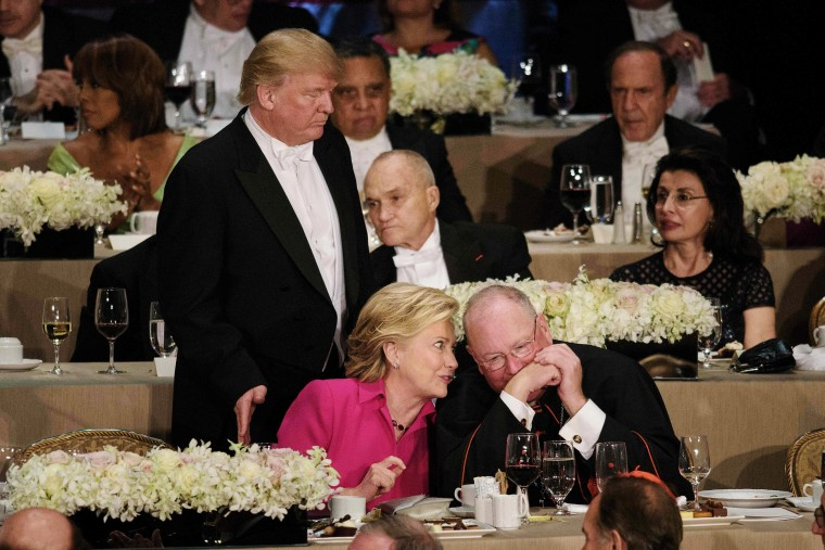 Image: Trump pats Clinton on the back at the Al Smith dinner