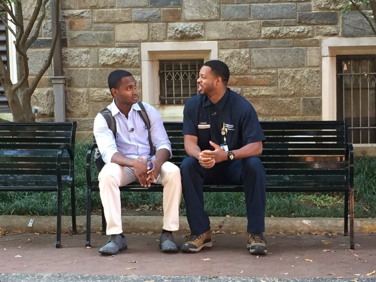 Oneil Batchelor talks with student Febin Bellamy on the campus of Georgetown University.