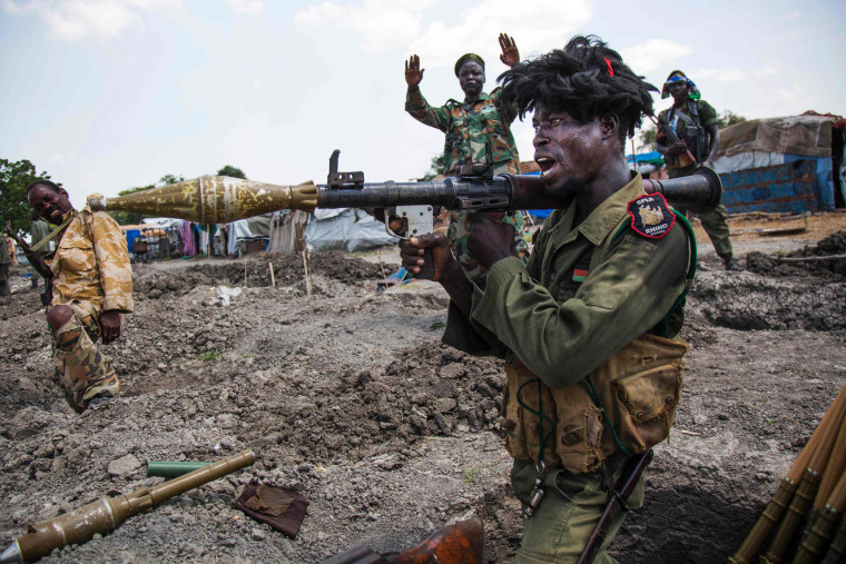 Image: Soldiers of the Sudan People Liberation Army (SPLA) celebrate while standing in trenches in Lelo
