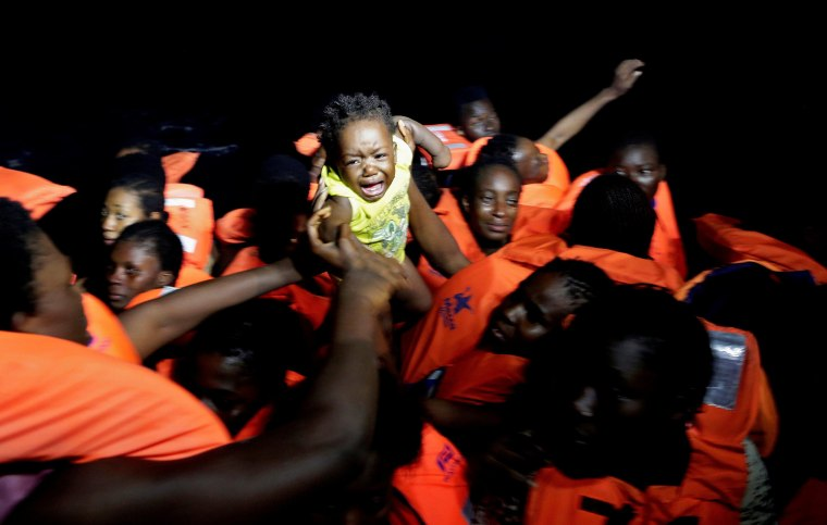 Image: Migrants are seen during rescue operation in the Mediterranea Sea