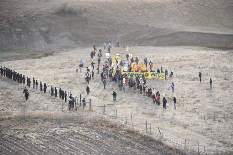 This photo provided by the Morton County Sheriff's Department shows some protesters and police during a demonstration against the Dakota Access pipeline project in Morton County, North Dakota, on Saturday, Oct. 22, 2016.