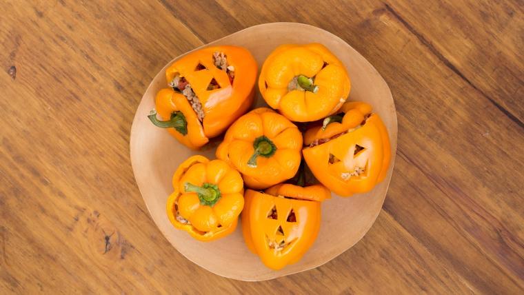 Jack-o-lantern stuffed peppers