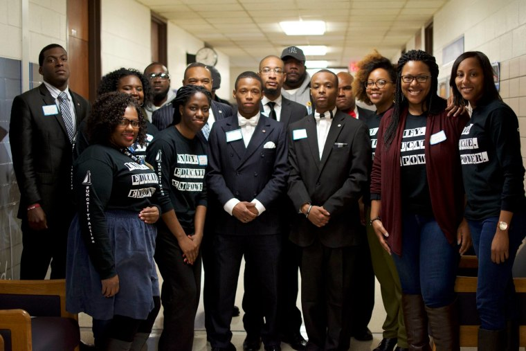 "Student leaders of the University of Kentucky's Black Graduate and Professional Students Association (UKBGPSA) and @ForBlackUK stand in the halls of the Taylor Education Building in April 2016. They say they are ""responding to the call"" to combat racism on their campus"