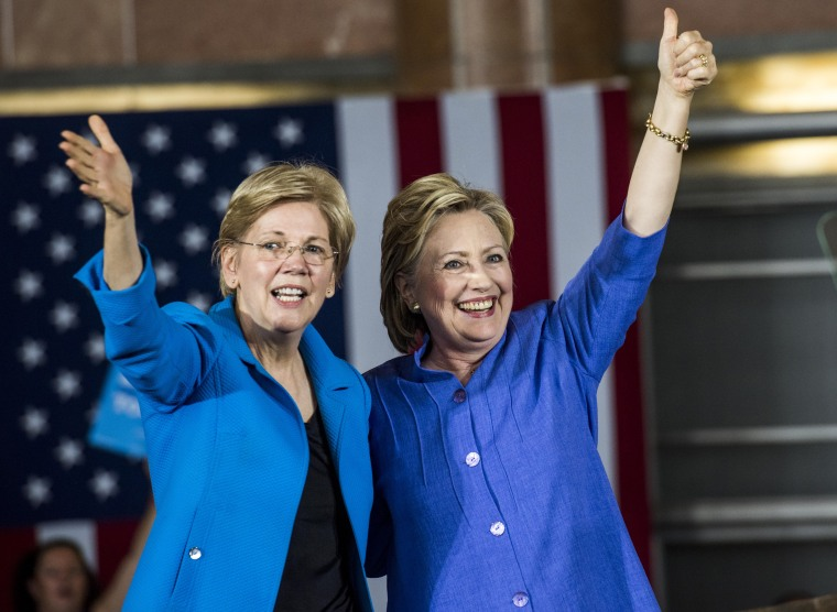 Image: Former Secretary of State Hillary Clinton accompanied by Senator Elizabeth Warren