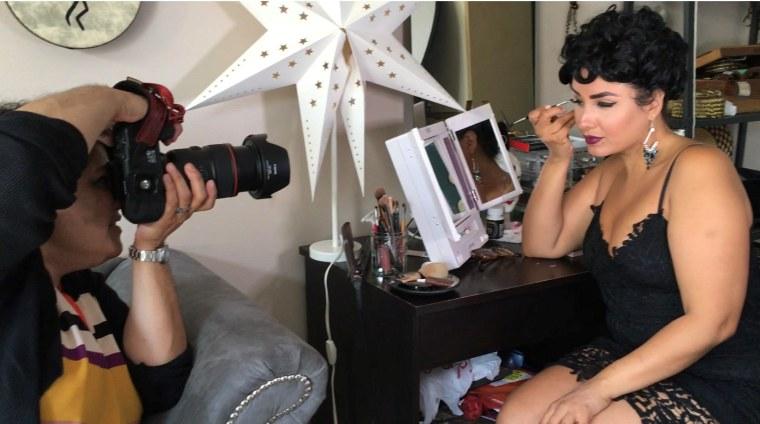 Linda Nieves-Powell and Rebecca Gitana Torres working on a photoshoot.