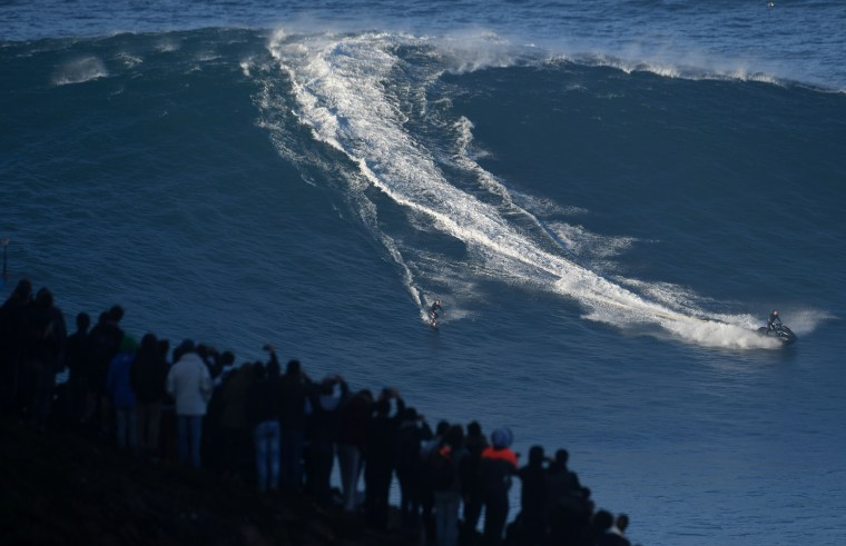Image: TOPSHOT-PORTUGAL-SURF-WAVE