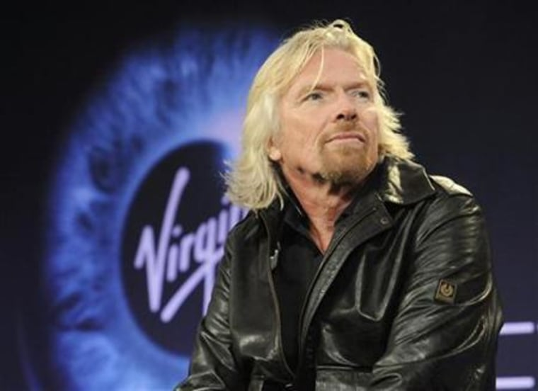 Billionaire Branson participates in a news conference before Virgin Galactic's unveiling of its new commercial spaceship SpaceShipTwo in Mojave