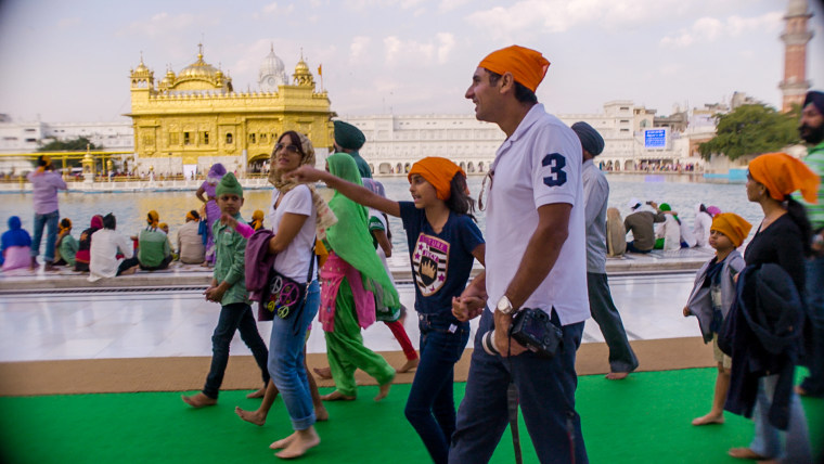 Harpreet Bedi, Satinder Garcha, and Zara Garcha at the Golden Temple in the holy city of Amritsar, India.