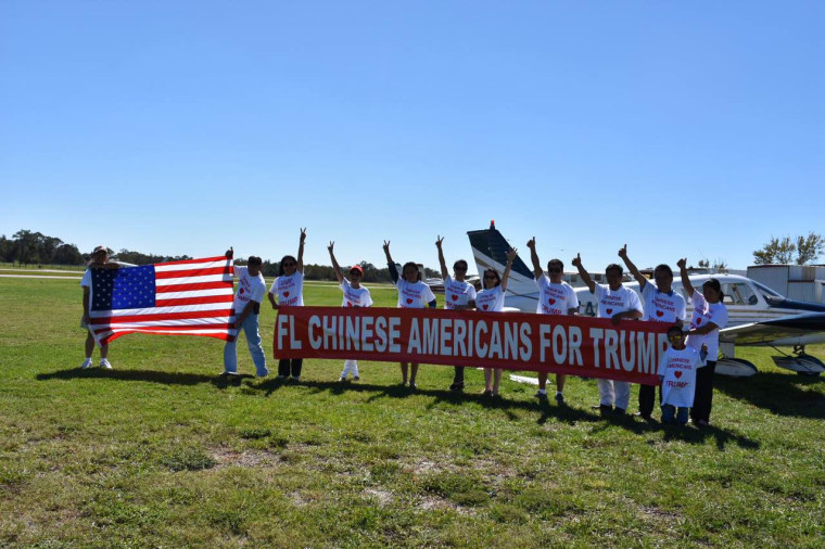 Members of Chinese Americans for Trump with a banner in the state of Florida.